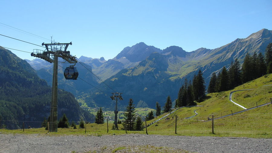 No Edit/no Filter Holiday Memories Switzerland Swiss Alps EyeEm Selects Mountain Cable Electricity  Outdoors Nature Day Mountain Range Overhead Cable Car Landscape Beauty In Nature No People Sky Tree Scenics