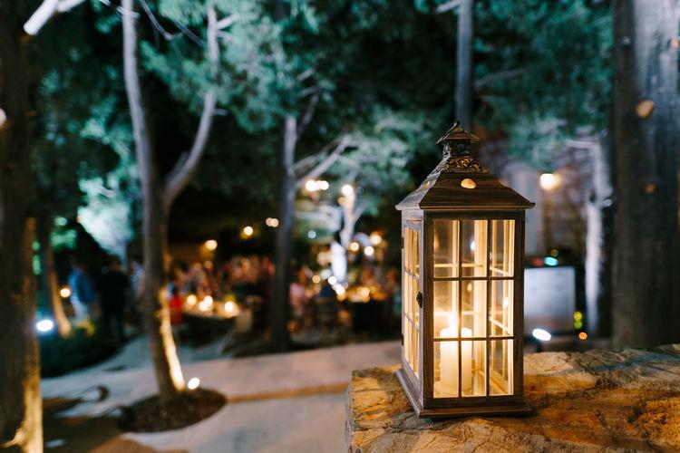 Illuminated lantern on street at night
