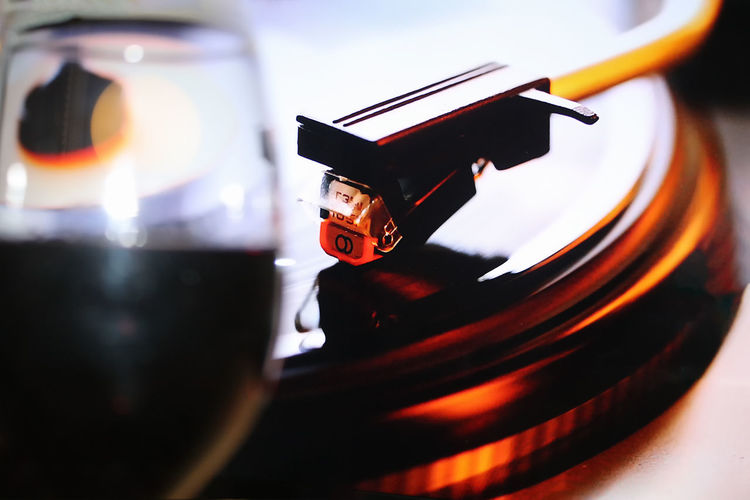 Close-up of wineglass and turntable