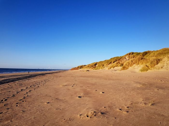 EyeEm Selects Beach Sand Sunny Sea Clear Sky Sand Dune Sky Landscape Traces In The Sand Beauty In Nature Blue Water Vacations Travel Destinations Netherlands Ouddorp Day No People Outdoors Breathing Space