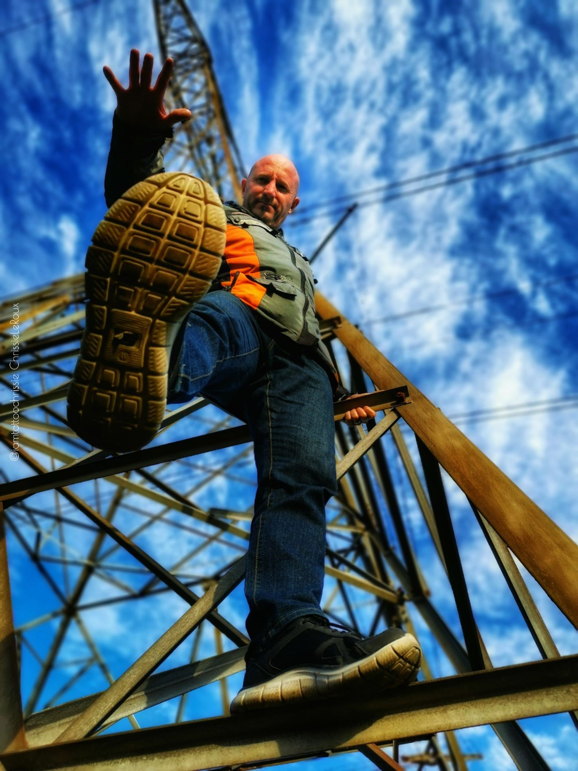 low angle view, men, one person, full length, sky, real people, day, males, leisure activity, lifestyles, cloud - sky, clothing, nature, blue, casual clothing, outdoors, standing, rope, warm clothing