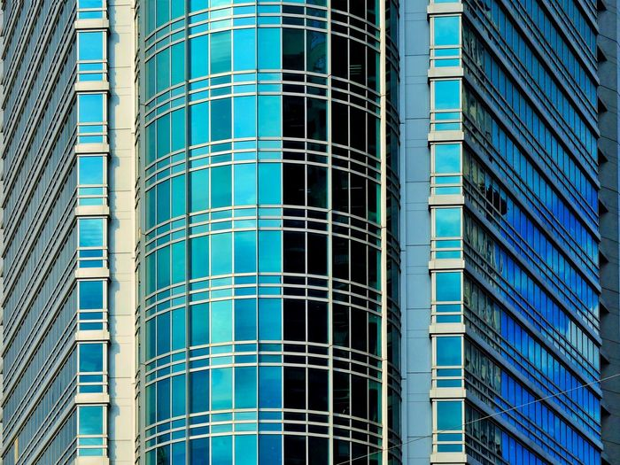 Architecture Building Exterior Skyscraper Window Modern Low Angle View Built Structure Full Frame Backgrounds Blue Day Outdoors Office City No People Cityscape Futuristic Facade Building Façade