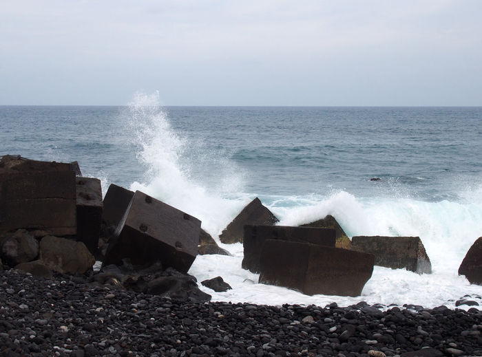 concrete square breakers and surf on the beach in tenerife Beach Beauty In Nature Breakers Breaking Crash Day Force Hitting Horizon Over Water Motion Nature No People Outdoors Power In Nature Sea Sky Water Wave