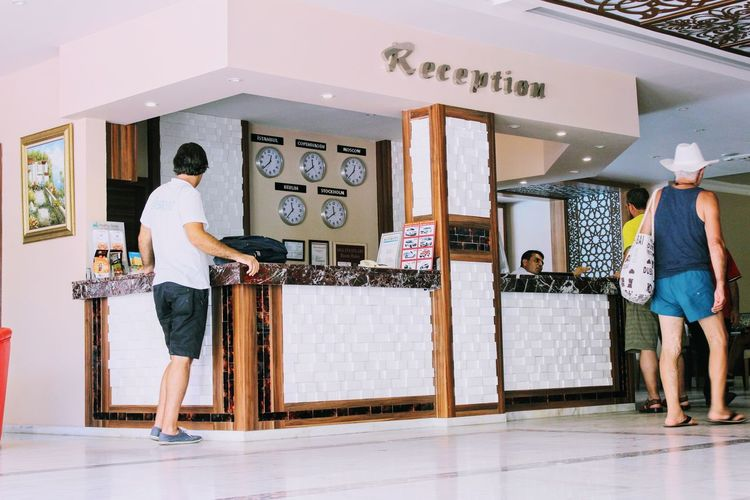 Kleopatra Beach Hotel Reception Adult Adults Only Casual Clothing Day Full Length Hotel Indoors  Kleopatra Beach Leisure Activity Lifestyles Men One Person People Real People Standing Young Adult