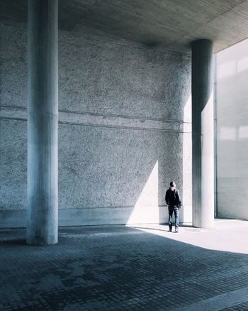 The light and archi impact. Architecture Built Structure Real People Architectural Column One Person Lifestyles Day Wall - Building Feature Full Length Leisure Activity Adult Standing Men Indoors  Nature Sunlight Rear View Women The Architect - 2018 EyeEm Awards The Street Photographer - 2018 EyeEm Awards The Fashion Photographer - 2018 EyeEm Awards