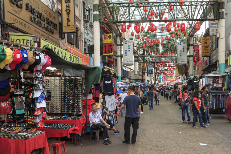 Kuala Lumpur, Malaysia: January 25, 2018: Tourists and local people visiting the Chinese Petaling Market in China Town of Kuala Lumpur ASIA Kuala Lumpur Petaling Market Rambutan Central Market Malaysia Market Merdeka Square Petronas Tower Religion Sentral Station Sentral Station Oslo Temple