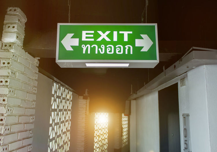 Low angle view of exit sign in building