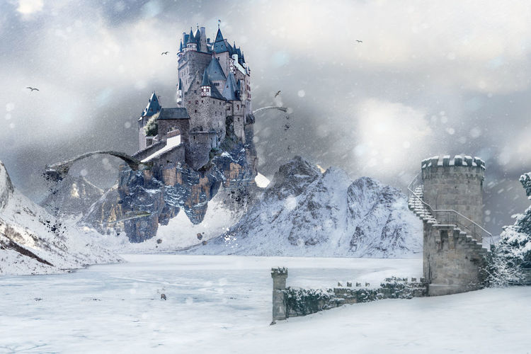 A flying Castle in the mystical mountainous landscape of Icy Wasteland with an old Tower Barents Sea, Castle, Northern, Northland, Town, Arctic, Atlantic, Coast, Cold, Fantasy, Fjord, Flying, Game Of Throns Like, Harbor, Ice, Landscape, Mountains, Mystic, Nature, Nordic, North, North Sea, Norway, Ocean, Outdoor, Outdoors, Polar Circle, Scandi Architecture Cloud - Sky Cold Temperature Day Nature No People Outdoors Sky Snow Transportation Water Weather Winter