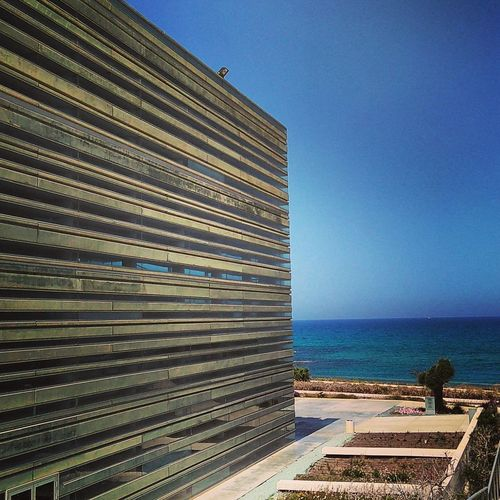 Peres Center and blue sky Sea Beach Architecture Business Finance And Industry No People Outdoors Sky Travel Destinations Modern Built Structure Skyscraper Day Clear Sky Blue Building Exterior Horizon Over Water Water Nature