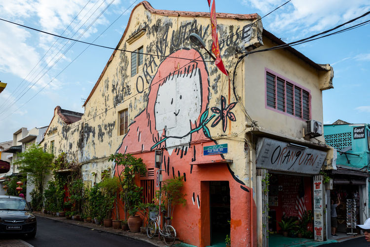 Malacca Architecture Building Exterior Built Structure Building City Sky Day Communication Nature Street No People Cloud - Sky Cable Residential District Text Graffiti Transportation Old Sign Outdoors Electricity  Power Supply Mural