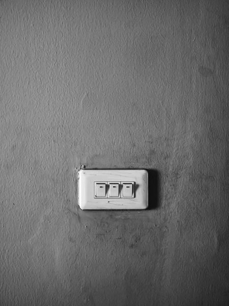 A close up of light switch on the concrete wall, black and white with copy space. Copy Space Isolated Light Power Switch Wall Architecture Black Blackandwhite Built Structure Close Up Close-up Concrete Wall Connection Day Electricity  Electricity  Grey Indoors  Light Switch No People Outlet Switch Wall - Building Feature White