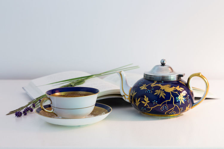 Coffee cup on table against white background