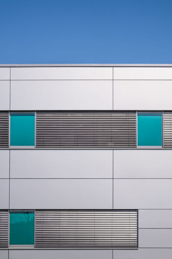Architecture Built Structure Building Exterior Pattern No People Building Blue Wall - Building Feature Modern Day Clear Sky Sky Low Angle View City Glass - Material Outdoors Geometric Shape Window Sunlight Office Building Exterior Silver Colored