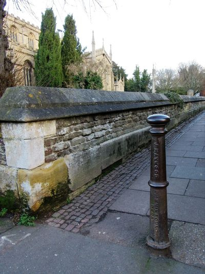 Old Bollard Alley Architecture Bollard Built Structure Churchyard Cobbles Day Iron - Metal Lettering No People Outdoors Stone Material Tree Wall Words