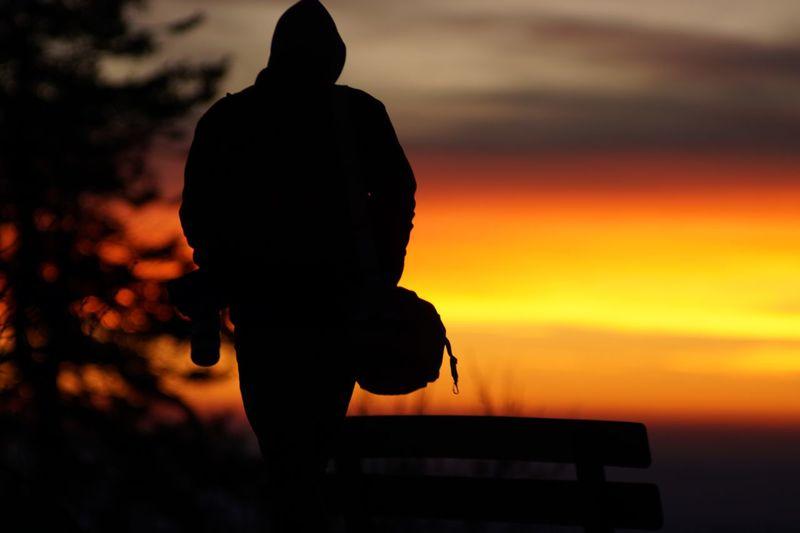 Rear view of silhouette man standing against orange sky - sonnenuntergang am großen feldberg