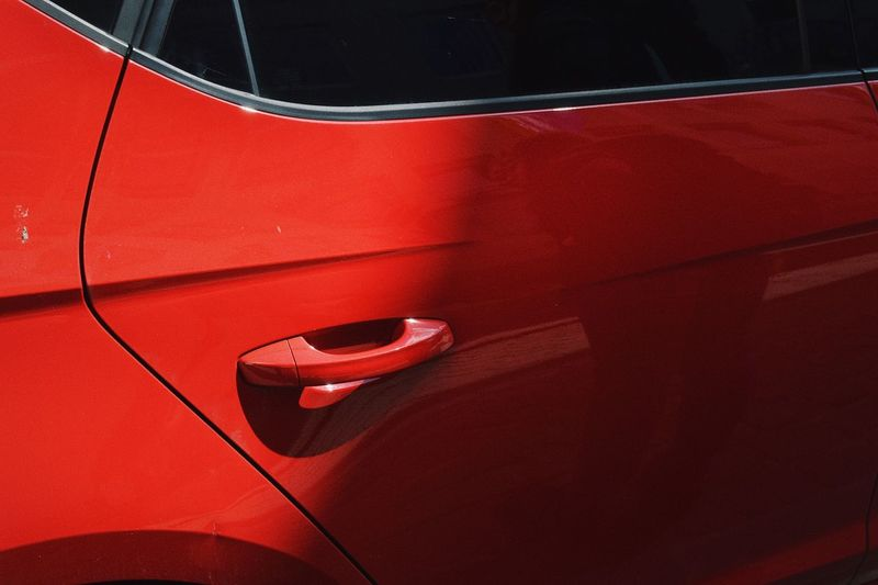 red Red Close-up Car No People Motor Vehicle Musical Instrument Mode Of Transportation Arts Culture And Entertainment Single Object Car Door Transportation Textured  Land Vehicle