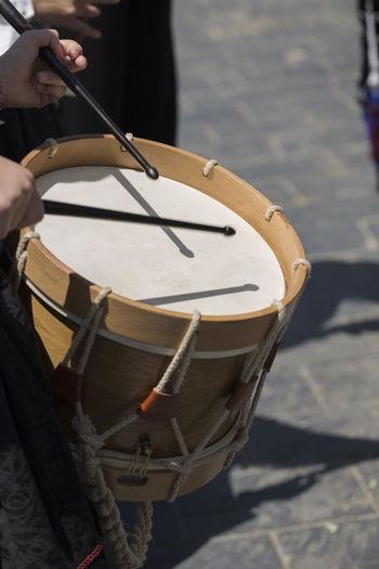 Man playing drum outdoors
