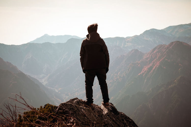 Mountain Mountain Range Scenics - Nature Beauty In Nature One Person Leisure Activity Non-urban Scene Standing Tranquil Scene Tranquility Real People Sky Rear View Lifestyles Hiking Adventure Activity Idyllic Nature Looking At View Outdoors Mountain Peak Goal Winner Archives
