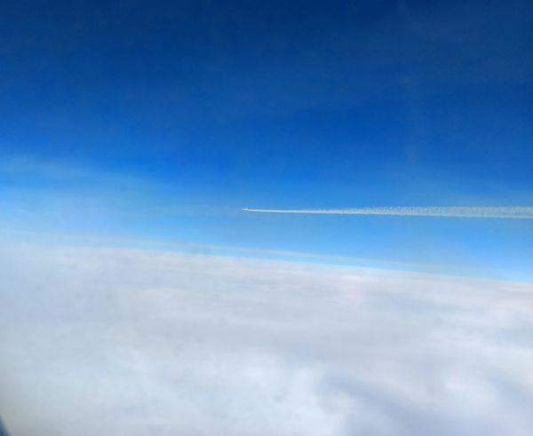 Capturing a flying airplane from another flying airplane, 17000 ft above ground level Flying High Airplane Airshow Air Vehicle Aerobatics Vapor Trail Aerial Photography Aerialview Aerial View Airplane From Another Airplane