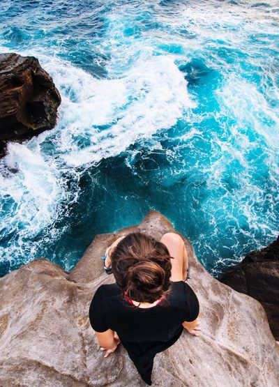 High Angle View Sea Rock - Object Water Rear View One Person Sitting Day One Woman Only Only Women Nature Outdoors Leisure Activity Adult Adults Only People Women Beauty In Nature Full Length One Young Woman Only The Great Outdoors - 2017 EyeEm Awards Live For The Story BYOPaper! Place Of Heart