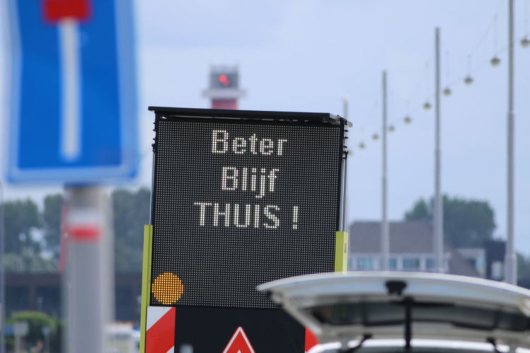 Close-up of road sign against blurred background