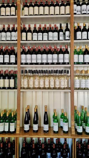 Bottles in shelf at store