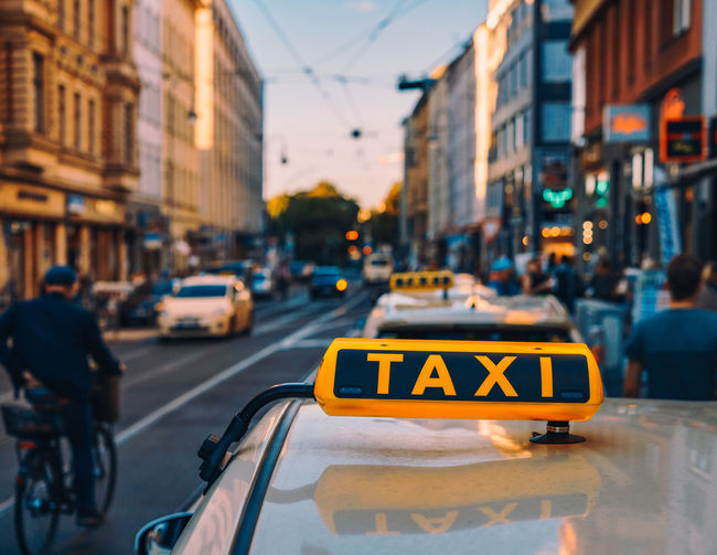 Close-up of taxi sign on city street