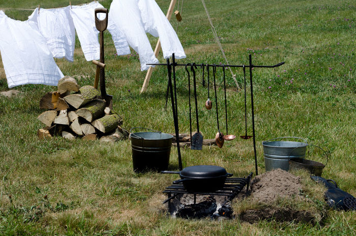 laundry flies on the close line, luckily upwind of the food cooking over an open camp fire Camp Fire Laundry Retro Camping Stove Cast Iron Cooking Cooking Down Wind Cooking Outdoors Day Field Fire Wood Food Grass Laundry On A Clothes Line Nature Old Fashioned ' Old Tools Outdoors Outdoors Photograpghy  The Fashion Photographer - 2018 EyeEm Awards