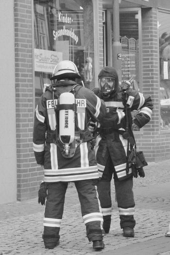 Firefighters I - team work Full Length City Building Exterior Front View Built Structure Responsibility Standing Day Adult People Architecture Police Force Men Real People Adults Only Outdoors Young Adult Only Men Firefighters In Action Firefighters The Portraitist - 2017 EyeEm Awards