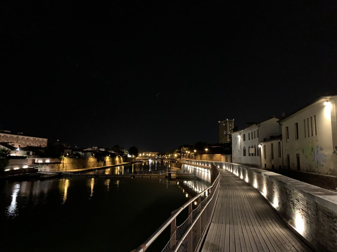 architecture, built structure, illuminated, night, building exterior, city, sky, water, building, nature, no people, direction, copy space, transportation, residential district, the way forward, reflection, outdoors, lighting equipment, canal