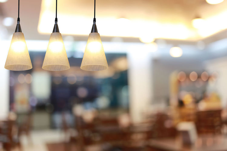 Close-up of illuminated lights hanging in restaurant