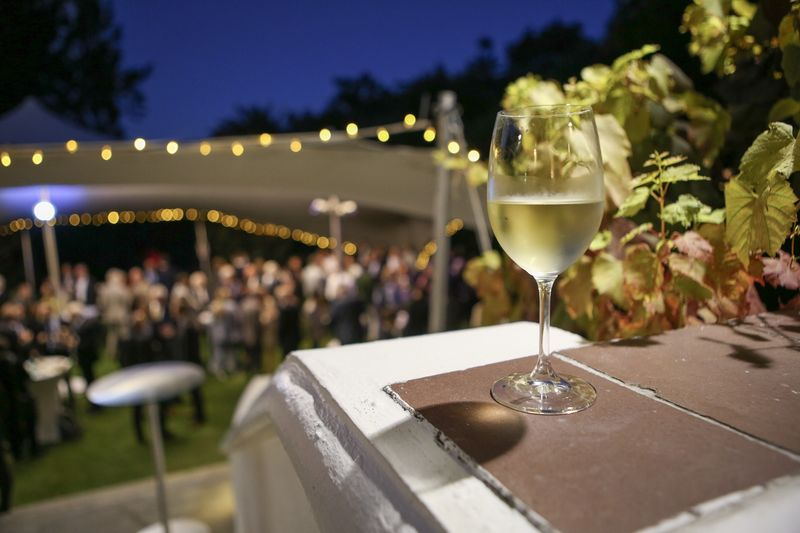 Close-up of white wine on table at garden party