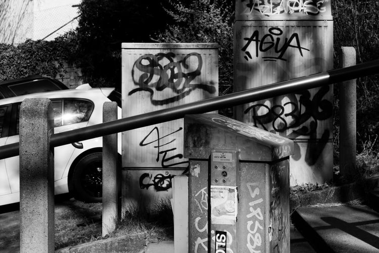 Attraktor Cars Architecture Art And Craft Blackandwhite Built Structure Communication Creativity Day Gate Graffiti Metal Monochrome Nature No People Outdoors Plant Railing Representation Sign Street Art Text Tree Urban Western Script