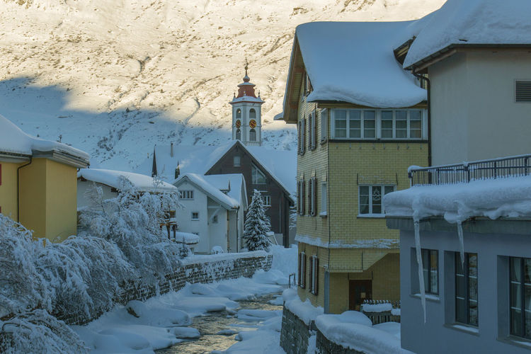Snow covered houses in town