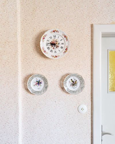 Close-up of clock against wall