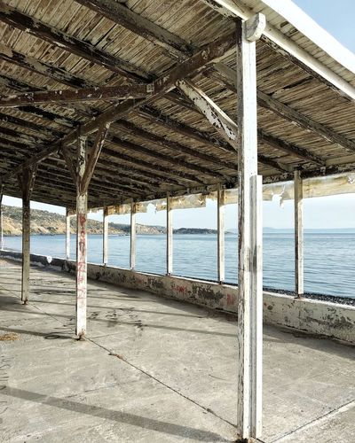 Scenic view of beach seen through roof