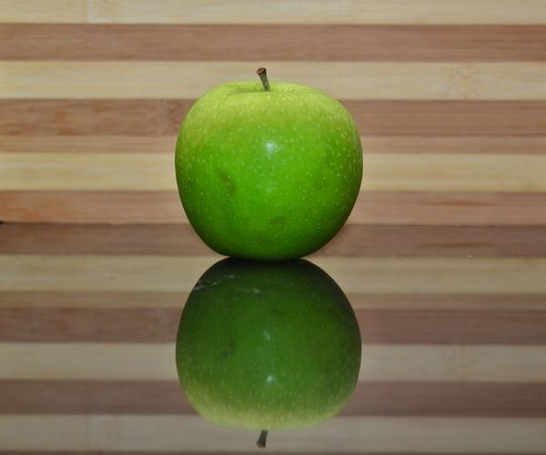 Reflection Fruit Green Color Food And Drink Food Healthy Eating Apple - Fruit Symmetry No People Freshness Indoors  Day Close-up Reflection Apple Stripes Pattern