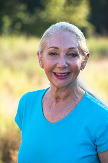 Healthy and fit mature woman Blonde Hair Blue Casual Clothing Close-up Day Fit Woman Focus On Foreground Front View Headshot Healthy Lifestyle Human Face Leisure Activity Lifestyles Mature Adult Mature Woman Outdoors Person Portrait Senior Senior Woman Toothy Smile Woman Woman Portrait