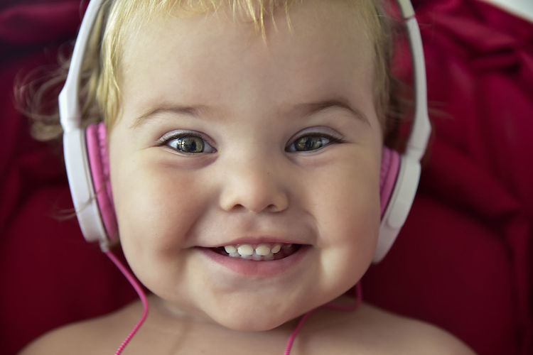 My baby playing around with headphones that were turned off and not plugged to any sound equipment Beautiful Girl Earphones Headphones Baby Babyhood Beautiful Eyes Body Part Cheerful Child Childhood Close-up Cute Emotion Front View Happiness Headset Headshot Human Body Part Human Face Innocence Looking At Camera One Person Portrait Smiling Young EyeEmNewHere Moments Of Happiness