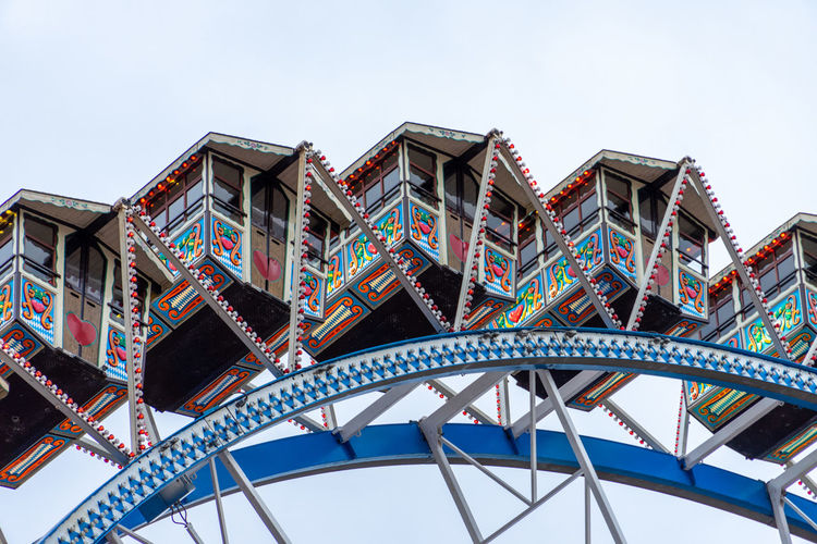 Low angle view of ferris wheel against building