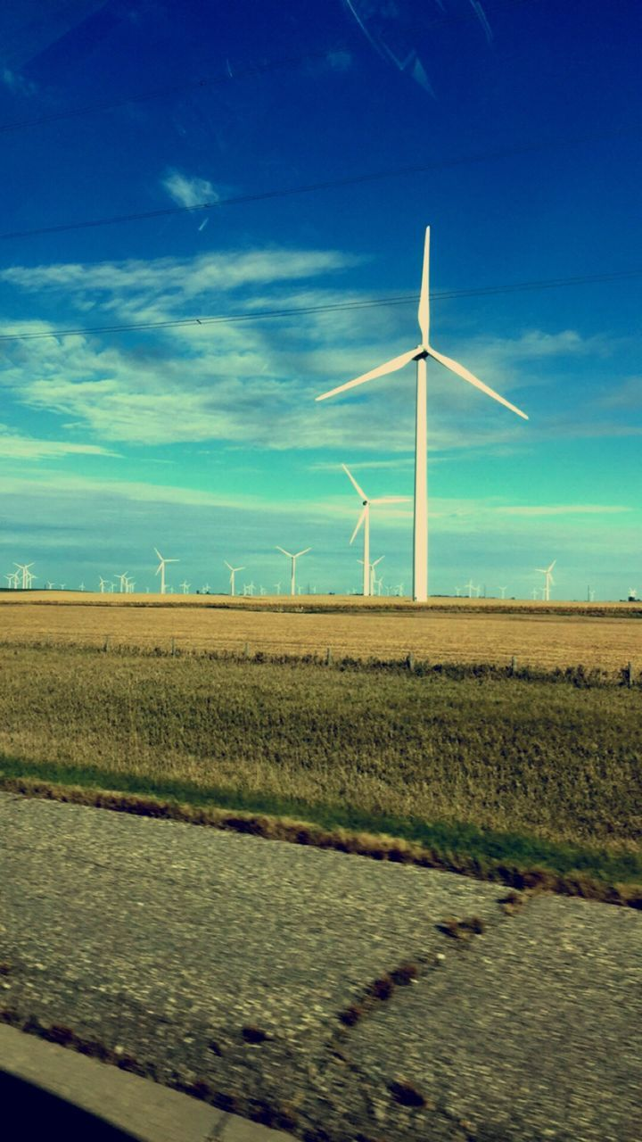 wind turbine, wind power, alternative energy, fuel and power generation, environmental conservation, renewable energy, windmill, sky, rural scene, industrial windmill, technology, field, electricity, landscape, nature, day, blue, no people, agriculture, outdoors, scenics, beauty in nature, traditional windmill
