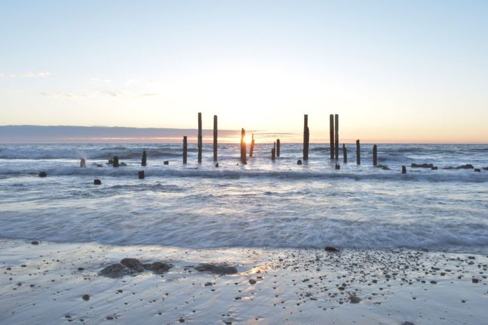 EyeEm Selects Sea Beach Water Nature Sunset Wooden Post Sand No People Outdoors Beauty In Nature Sky Day
