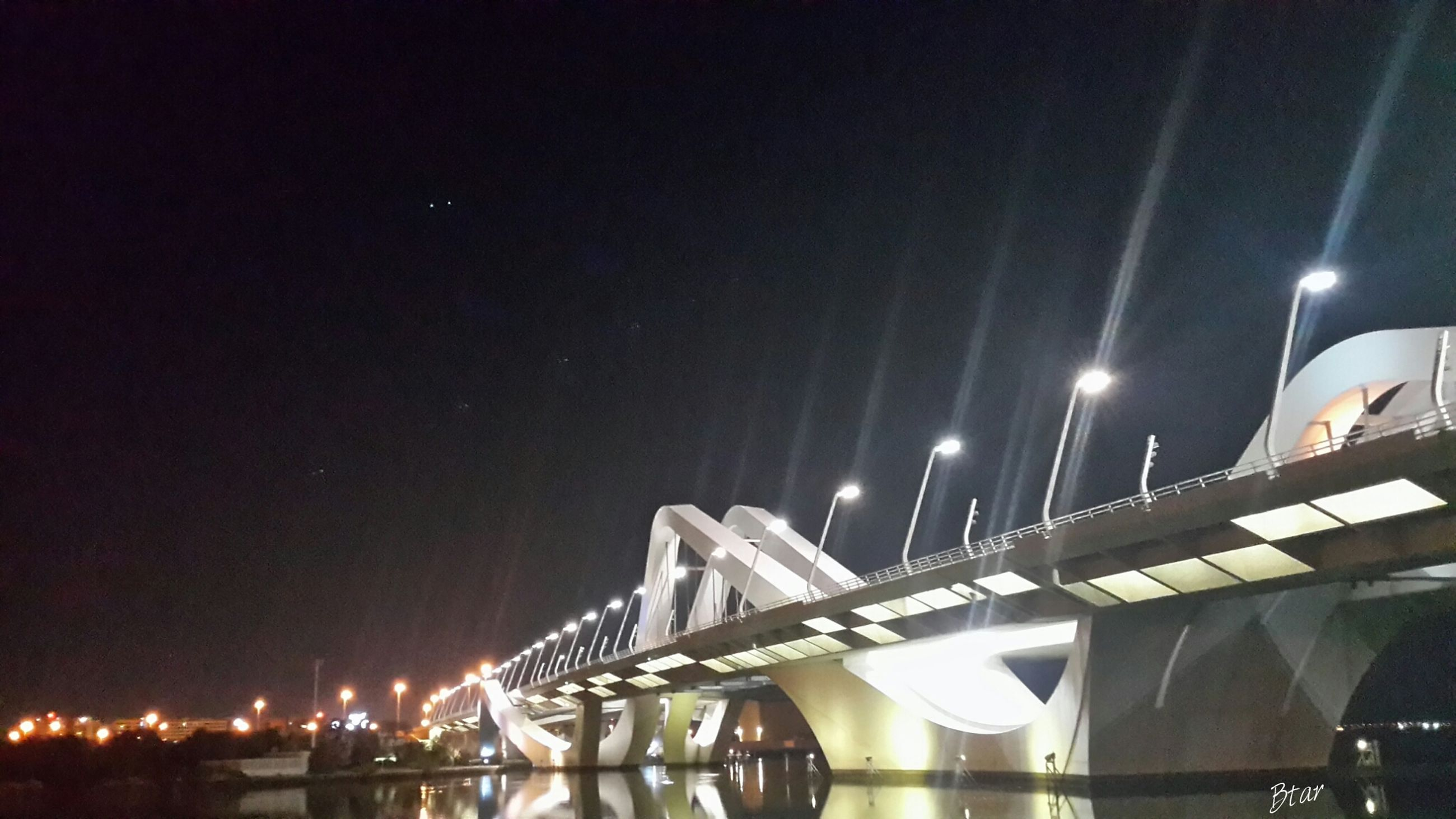 night, illuminated, architecture, built structure, connection, bridge - man made structure, low angle view, sky, building exterior, engineering, city, copy space, clear sky, river, bridge, modern, no people, lighting equipment, outdoors, moon