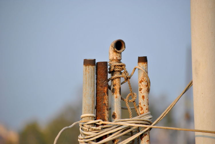 Abandoned Blue Sky Cable Clear Sky Close-up Coin Crisis Day Man Made Object Metal Metallic Minimalism No People Outdoors Periscope Photography Picoftheday Pipeline Rusted Rusty Sky Source Of Water Unused Vintage Wires