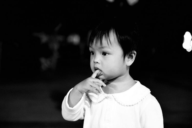 Close-up of girl with finger in mouth