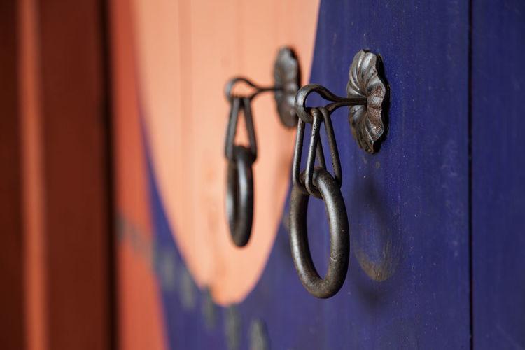 Close-up of knocker on wooden temple door