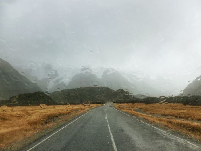 Beauty In Nature Cloud - Sky Day Diminishing Perspective Empty Empty Road Idyllic Landscape Long Mount Cook National Park Mountain No People Non-urban Scene Outdoors Rain On The Window Remote Road Scenics Season  Sky The Way Forward Tranquil Scene Tranquility Vanishing Point Weather