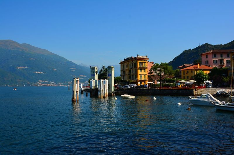 Houses by lake como against sky