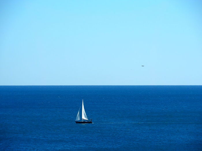 Sea Horizon Over Water Horizon Water Nautical Vessel Sky Sailboat Scenics - Nature Blue Sailing Waterfront Clear Sky Copy Space Beauty In Nature Tranquil Scene Mode Of Transportation Transportation Tranquility Nature No People Yacht Yachting