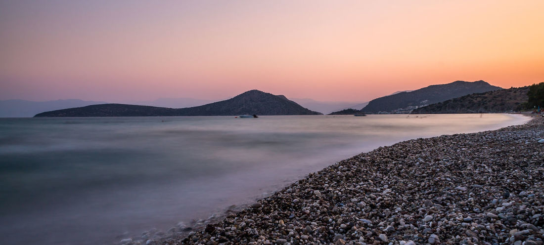Sunset over the beach with smooth water Beach Beauty In Nature Clear Sky Day Horizon Over Water Landscape Landscape_photography Longexposure Longexposurephotography Mountain Nature No People Outdoors Power In Nature Scenics Sea Sky Sunset Tranquil Scene Tranquility Travel Destinations Water